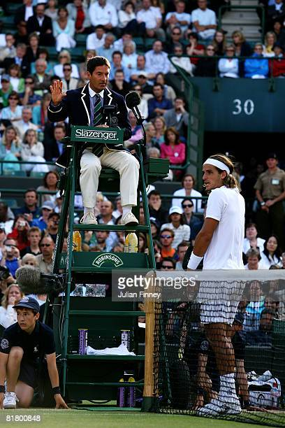 Feliciano Lopez of Spain complains to the Umpire during the Men's Quarter Final match against Marat Safin of Russia on day nine of the Wimbledon Lawn...
