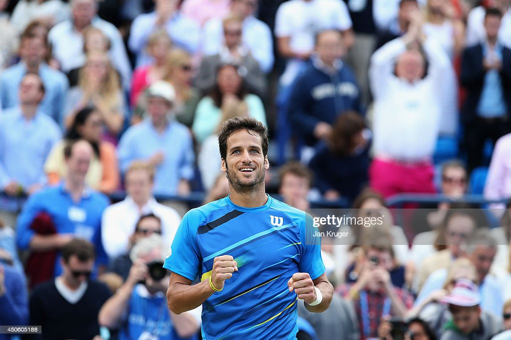 Feliciano Lopez of Spain defeats Radek Stepanek of the Czech Republic of Switzerland during their Men's Singles semi-final match on day six of the Aegon Championships at Queens Club on June 14, 2014 in London, England.