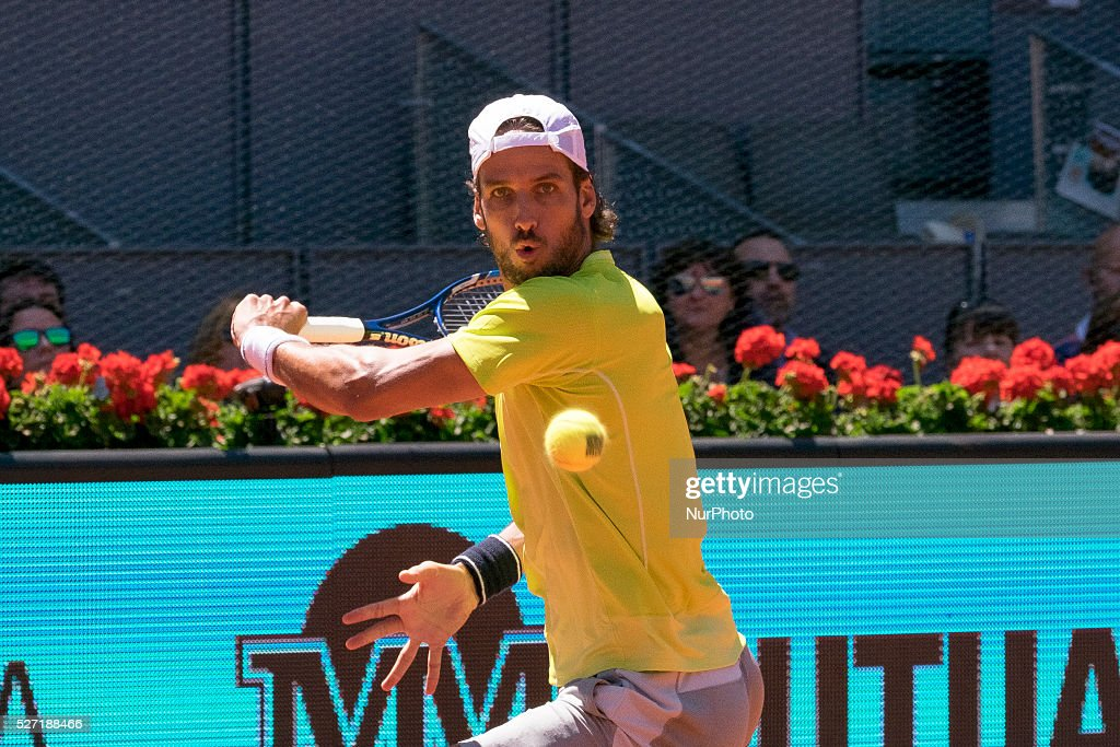 <a gi-track='captionPersonalityLinkClicked' href=/galleries/search?phrase=Feliciano+Lopez&family=editorial&specificpeople=206172 ng-click='$event.stopPropagation()'>Feliciano Lopez</a> of Spain during day three of the Mutua Madrid Open tennis tournament at the Caja Magica on May 02, 2016 in Madrid,Spain.