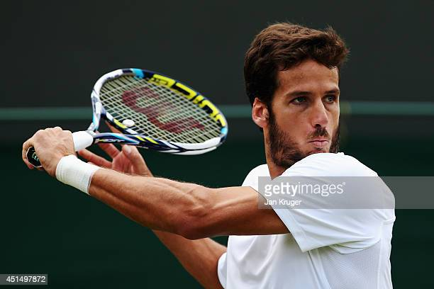 Feliciano Lopez of Spain during his Gentlemen's Singles third round match against John Isner of the United States on day seven of the Wimbledon Lawn...