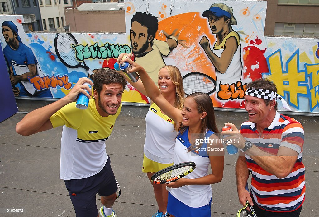 <a gi-track='captionPersonalityLinkClicked' href=/galleries/search?phrase=Feliciano+Lopez&family=editorial&specificpeople=206172 ng-click='$event.stopPropagation()'>Feliciano Lopez</a> of Spain, <a gi-track='captionPersonalityLinkClicked' href=/galleries/search?phrase=Elina+Svitolina&family=editorial&specificpeople=7026504 ng-click='$event.stopPropagation()'>Elina Svitolina</a> of Ukraine, Monica Puig of Puerto Rico and <a gi-track='captionPersonalityLinkClicked' href=/galleries/search?phrase=Pat+Cash&family=editorial&specificpeople=208695 ng-click='$event.stopPropagation()'>Pat Cash</a> of Australia pose with cans of spray paint after painting street art with Melbourne graffiti artist Daniel Wenn (unseen) during the ellesse Tennis Performance Apparel Launch on January 17, 2014 in Melbourne, Australia. The new range of tennis performance apparel will be worn by <a gi-track='captionPersonalityLinkClicked' href=/galleries/search?phrase=Feliciano+Lopez&family=editorial&specificpeople=206172 ng-click='$event.stopPropagation()'>Feliciano Lopez</a>, <a gi-track='captionPersonalityLinkClicked' href=/galleries/search?phrase=Elina+Svitolina&family=editorial&specificpeople=7026504 ng-click='$event.stopPropagation()'>Elina Svitolina</a> and Monica Puig at the Australian Open.