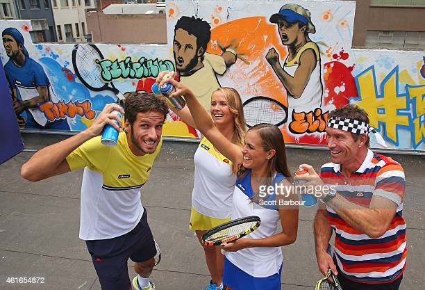 Feliciano Lopez of Spain Elina Svitolina of Ukraine Monica Puig of Puerto Rico and Pat Cash of Australia pose with cans of spray paint after painting...