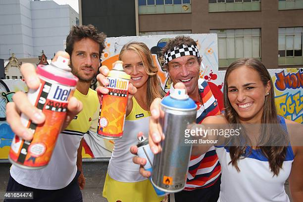 Feliciano Lopez of Spain Elina Svitolina of Ukraine Pat Cash of Australia and Monica Puig of Puerto Rico pose after painting street art with...