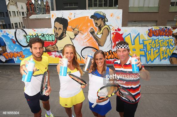 Feliciano Lopez of Spain Elina Svitolina of Ukraine Pat Cash of Australia and Monica Puig of Puerto Rico pose with cans of spray paint after painting...