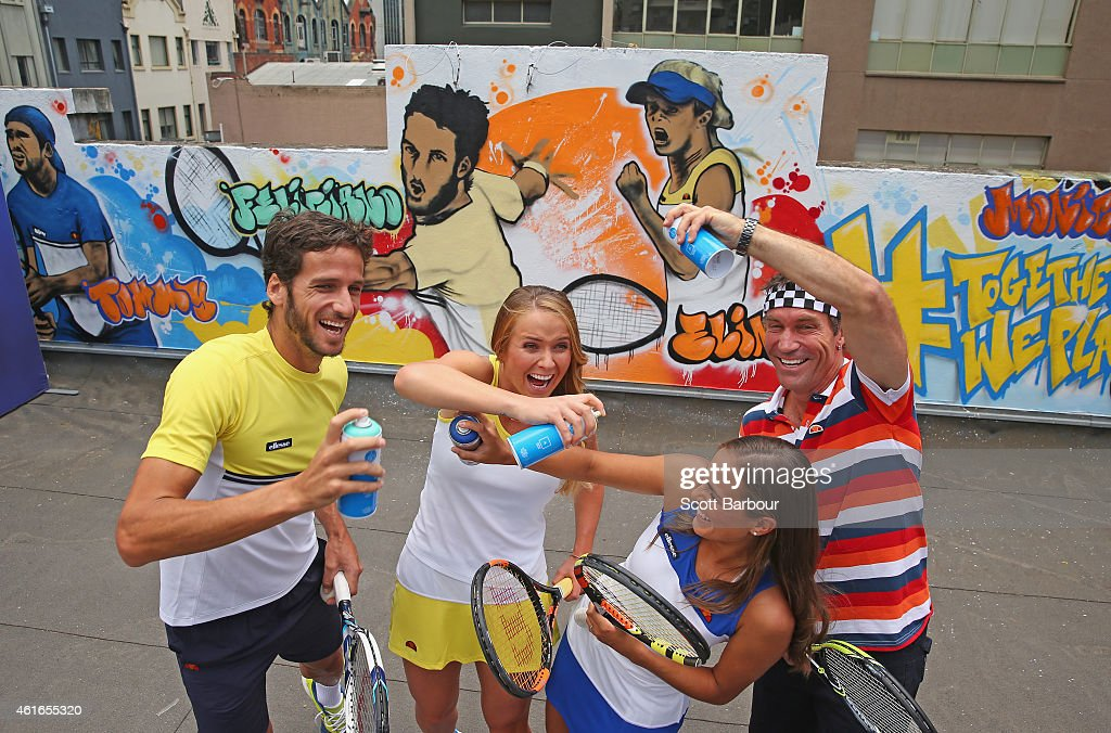 Feliciano Lopez of Spain, Elina Svitolina of Ukraine, Pat Cash of Australia and Monica Puig of Puerto Rico pose with cans of spray paint after painting street art with Melbourne graffiti artist Daniel Wenn (unseen) during the ellesse Tennis Performance Apparel Launch on January 17, 2014 in Melbourne, Australia. The new range of tennis performance apparel will be worn by Feliciano Lopez, Elina Svitolina and Monica Puig at the Australian Open.