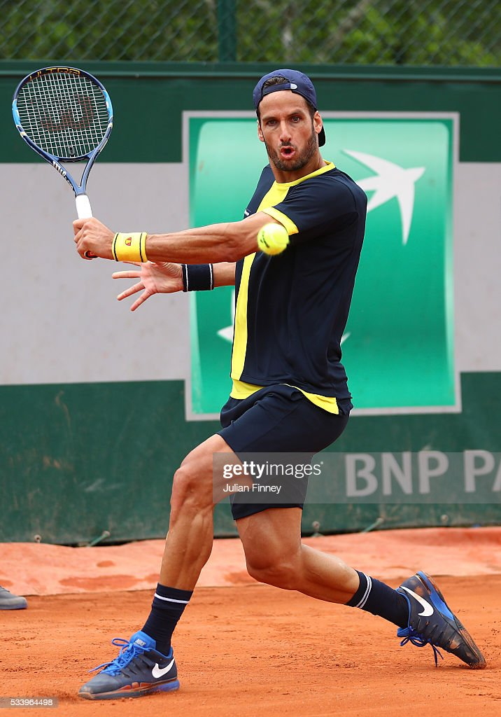 <a gi-track='captionPersonalityLinkClicked' href=/galleries/search?phrase=Feliciano+Lopez&family=editorial&specificpeople=206172 ng-click='$event.stopPropagation()'>Feliciano Lopez</a> of Spain hits a backhand during the Men's Singles first round match against Thomas Fabbiano of Italy on day three of the 2016 French Open at Roland Garros on May 24, 2016 in Paris, France.
