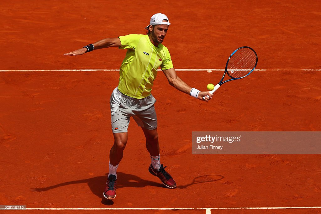 Feliciano Lopez of Spain in action against Roberto Bautista Agut of Spain during day five of the Mutua Madrid Open tennis tournament at the Caja Magica on May 04, 2016 in Madrid, Spain.