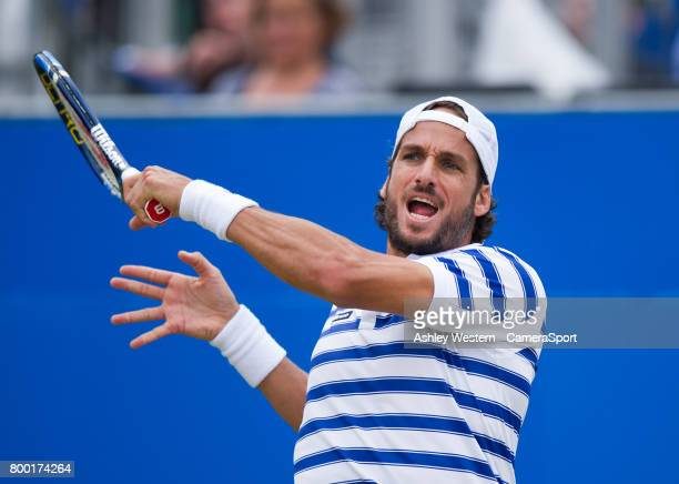 Feliciano Lopez of Spain in action during his victory over Tomas Berdych of The Czech Republic in their Men's Singles Quarter Final Match during Day...