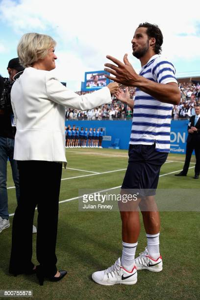 Feliciano Lopez of Spain is interviewed by Sue Barker following victory in the mens singles final against Marin Cilic of Croatia during day seven of...