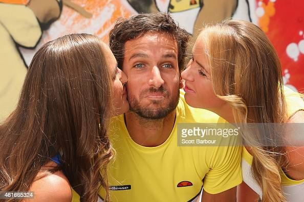 Feliciano Lopez of Spain is kissed by Monica Puig of Puerto Rico and Elina Svitolina of Ukraine after painting street art with Melbourne graffiti...