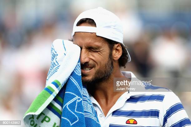 Feliciano Lopez of Spain looks dejected during the mens singles quarter final match against Tomas Berdych of The Czech Republic on day five of the...