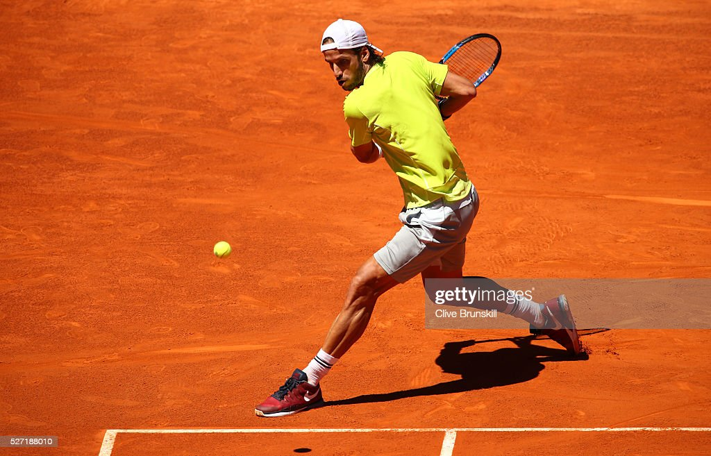<a gi-track='captionPersonalityLinkClicked' href=/galleries/search?phrase=Feliciano+Lopez&family=editorial&specificpeople=206172 ng-click='$event.stopPropagation()'>Feliciano Lopez</a> of Spain plays a backhand against Leonardo Mayer of Argentina in their first round match during day three of the Mutua Madrid Open tennis tournament at the Caja Magica on May 02, 2016 in Madrid,Spain.