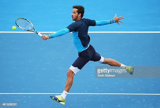 Feliciano Lopez of Spain plays a backhand during his match against Richard Gasquet of France during day two of the Priceline Pharmacy Classic at...