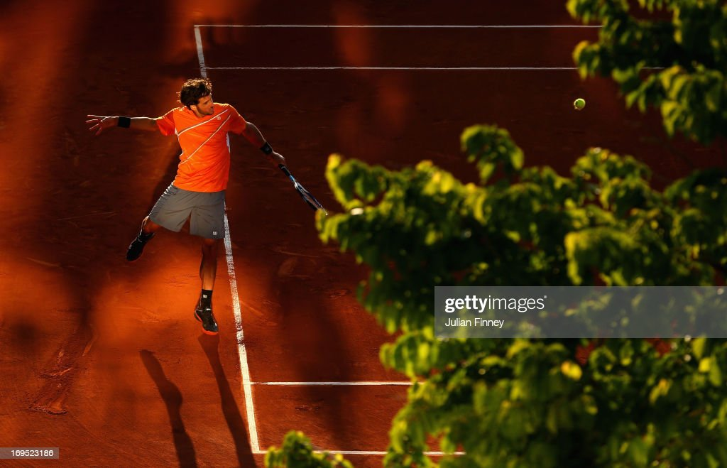 <a gi-track='captionPersonalityLinkClicked' href=/galleries/search?phrase=Feliciano+Lopez&family=editorial&specificpeople=206172 ng-click='$event.stopPropagation()'>Feliciano Lopez</a> of Spain plays a backhand during his men's singles match against Marcel Granollers of Spain on day one of the French Open at Roland Garros on May 26, 2013 in Paris, France.