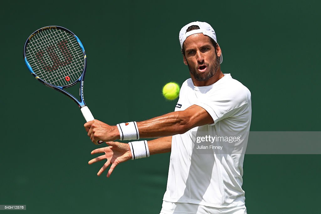 <a gi-track='captionPersonalityLinkClicked' href=/galleries/search?phrase=Feliciano+Lopez&family=editorial&specificpeople=206172 ng-click='$event.stopPropagation()'>Feliciano Lopez</a> of Spain plays a backhand during the Men's Singles first round match against Rajeev Ram of The United States on day two of the Wimbledon Lawn Tennis Championships at the All England Lawn Tennis and Croquet Club on June 28, 2016 in London, England.