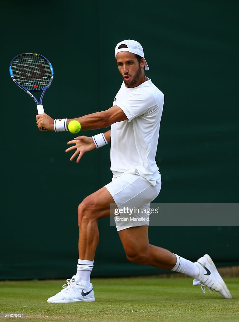 Feliciano Lopez of Spain plays a backhand during the Men's Singles second round match against Fabio Fognini of Italy on day five of the Wimbledon Lawn Tennis Championships at the All England Lawn Tennis and Croquet Club on July 1, 2016 in London, England.