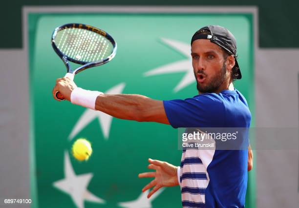 Feliciano Lopez of Spain plays a backhand during the mens singles first round match against Bjorn Fratangelo of The United States on day two of the...