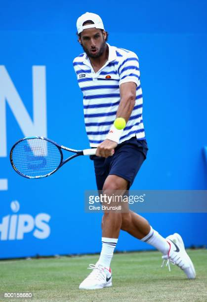 Feliciano Lopez of Spain plays a backhand during the mens singles quarter final match against Thomas Berdych of The Czech Republic on day five of the...