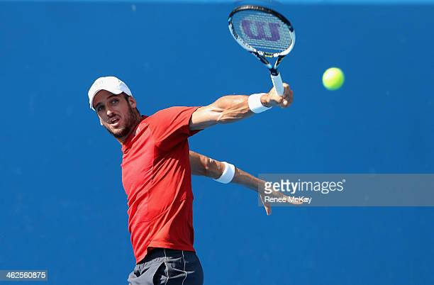 Feliciano Lopez of Spain plays a backhand in his first round match against Somdev Devvarman of India during day two of the 2014 Australian Open at...