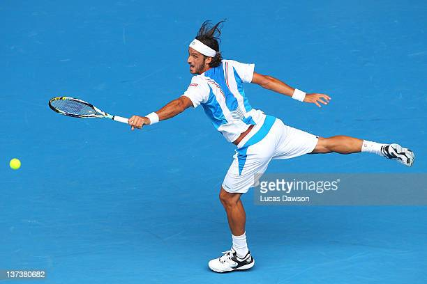 Feliciano Lopez of Spain plays a backhand in his third round match against John Isner of the United States of America during day five of the 2012...