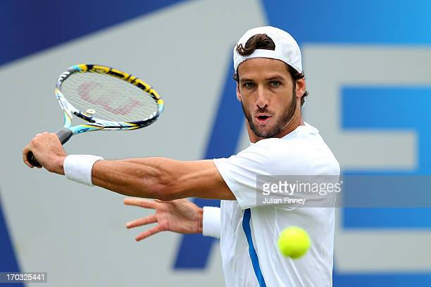 Feliciano Lopez of Spain plays a backhand shot during his Men's Singles first round match against Ricardas Berankis of Lithuania on day two of the...