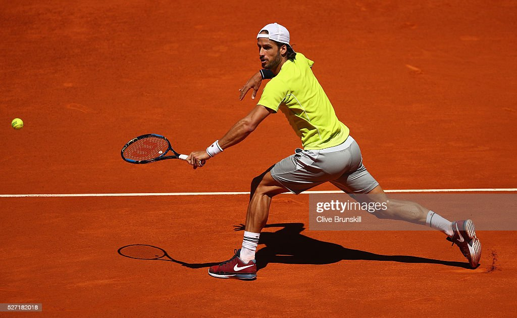 Feliciano Lopez of Spain plays a backhand volley against Leonardo Mayer of Argentina in their first round match during day three of the Mutua Madrid Open tennis tournament at the Caja Magica on May 02, 2016 in Madrid,Spain.