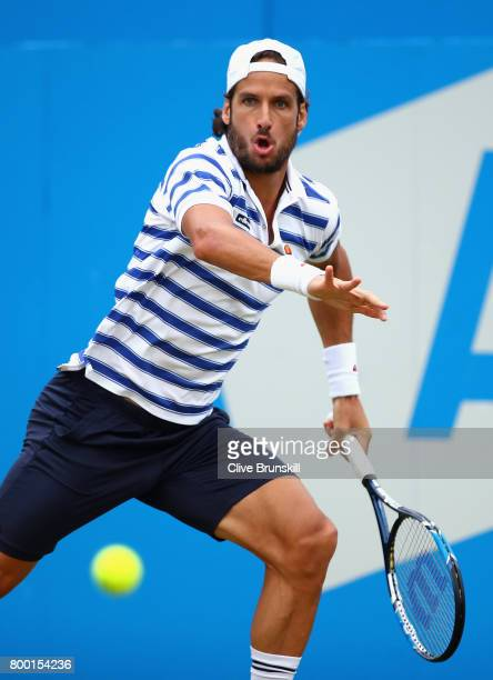Feliciano Lopez of Spain plays a forehand during the mens singles quarter final match against Thomas Berdych of The Czech Republic on day five of the...