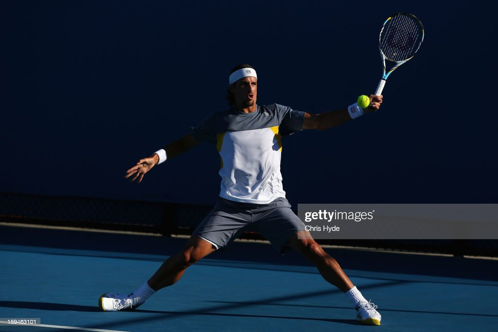 Feliciano Lopez of Spain plays a forehand in his first round match against Arnau Brugues-Davi of Spain during day one of the 2013 Australian Open at Melbourne Park on January 14, 2013 in Melbourne, Australia.
