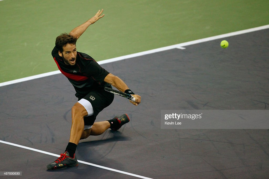 Feliciano Lopez of Spain plays backhand during his match against Mikail Youzhny of Russia during day 6 of the Shanghai Rolex Masters at Zi Zhong stadium on October 10, 2014 in Shanghai, China.
