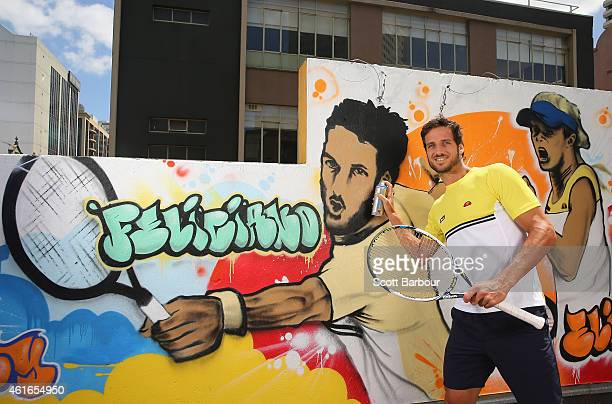Feliciano Lopez of Spain poses with a can of spray paint after painting street art with Melbourne graffiti artist Daniel Wenn during the ellesse...