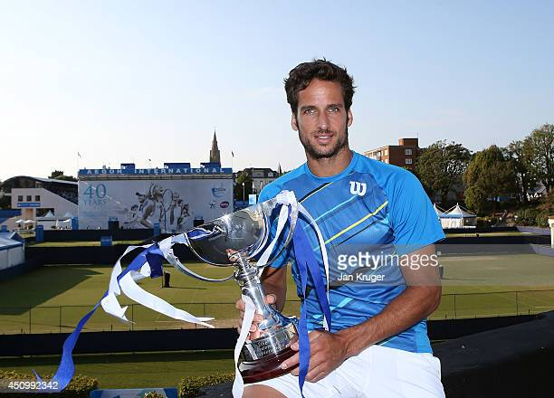 Feliciano Lopez of Spain poses with the trophy after beating Richard Gasquet of France during their Men's Singles Finals match on day eight of the...