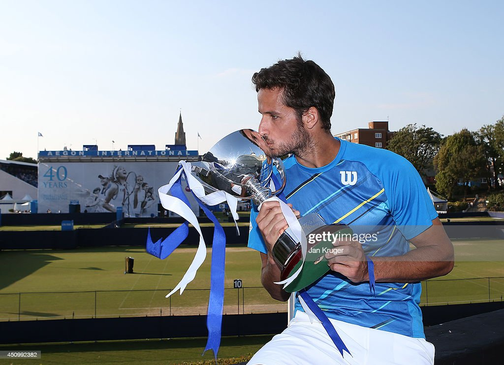 <a gi-track='captionPersonalityLinkClicked' href=/galleries/search?phrase=Feliciano+Lopez&family=editorial&specificpeople=206172 ng-click='$event.stopPropagation()'>Feliciano Lopez</a> of Spain poses with the trophy after beating Richard Gasquet of France during their Men's Singles Finals match on day eight of the Aegon International at Devonshire Park on June 21, 2014 in Eastbourne, England.