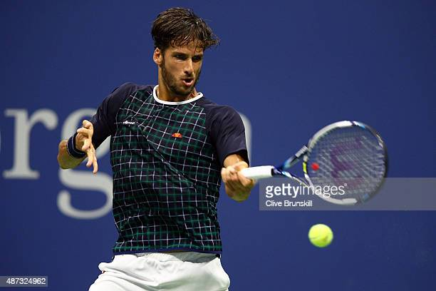 Feliciano Lopez of Spain returns a shot against Novak Djokovic of Serbia during their Men's Singles Quarterfinals match on Day Nine of the 2015 US...