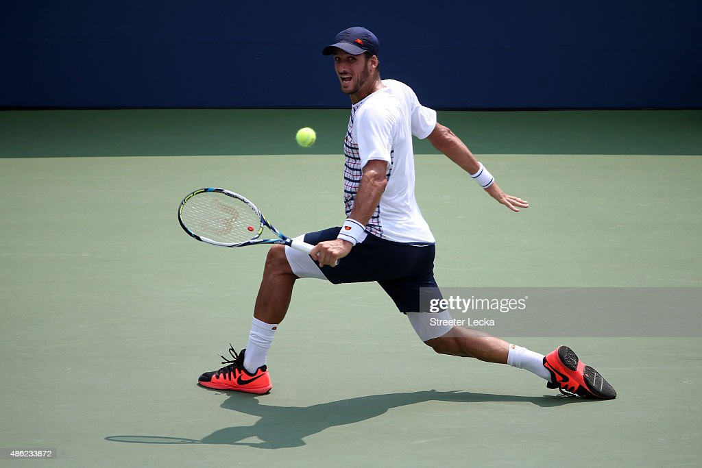 Feliciano Lopez of Spain returns a shot to Mardy Fish of the United States during their Men's Singles Second Round match on Day Three of the 2015 US Open at the USTA Billie Jean King National Tennis Center on September 2, 2015 in the Flushing neighborhood of the Queens borough of New York City.