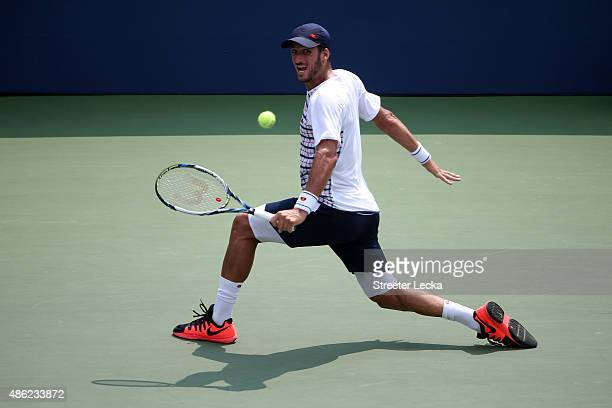 Feliciano Lopez of Spain returns a shot to Mardy Fish of the United States during their Men's Singles Second Round match on Day Three of the 2015 US...