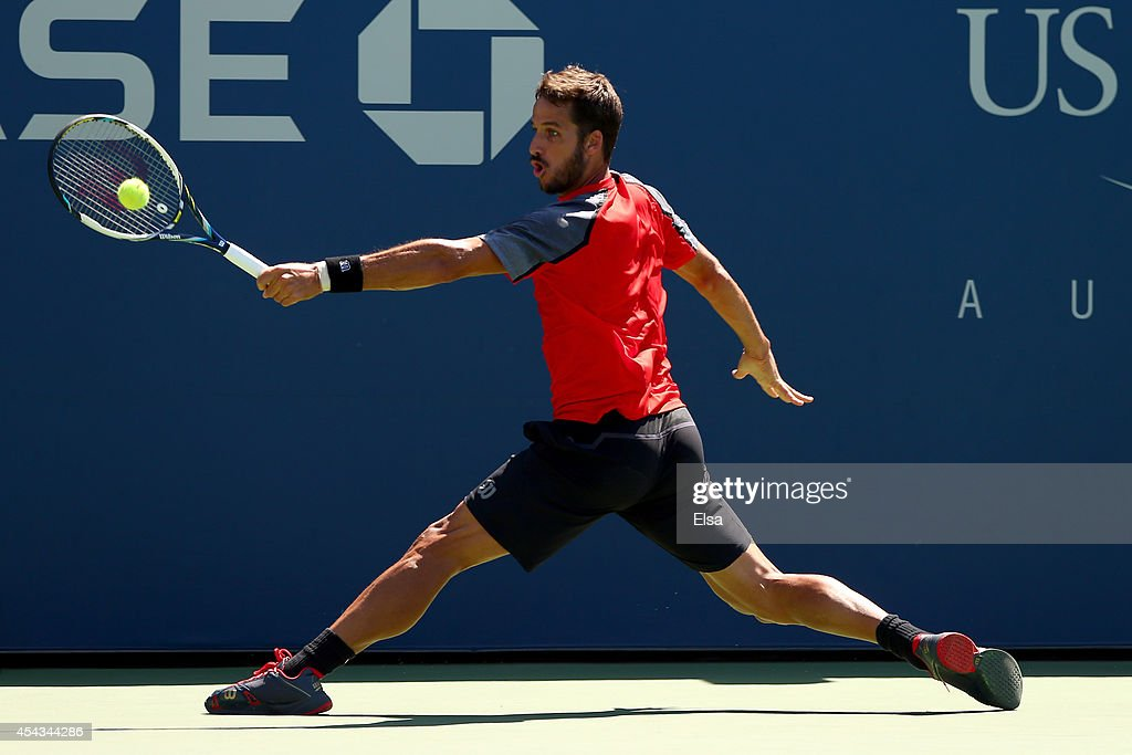 Feliciano Lopez of Spain returns a shot to Tatsuma Ito of Japan during their men's singles second round match on Day Five of the 2014 US Open at the USTA Billie Jean King National Tennis Center on August 29, 2014 in the Flushing neighborhood of the Queens borough of New York City.