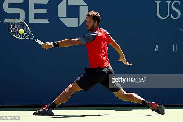 Feliciano Lopez of Spain returns a shot to Tatsuma Ito of Japan during their men's singles second round match on Day Five of the 2014 US Open at the...