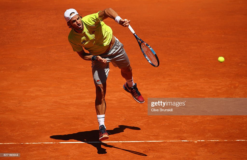 Feliciano Lopez of Spain serves against Leonardo Mayer of Argentina in their first round match during day three of the Mutua Madrid Open tennis tournament at the Caja Magica on May 02, 2016 in Madrid,Spain.