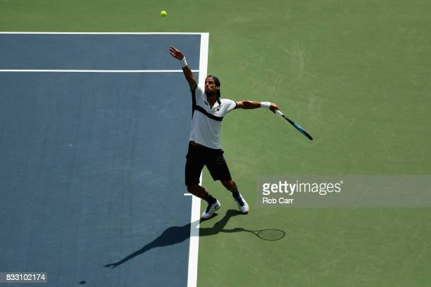 Feliciano Lopez of Spain serves to Grigor Dimitrov of Bulgaria during Day 5 of the Western Southern Open at the Linder Family Tennis Center on August...