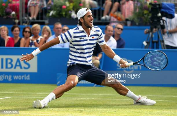 Feliciano Lopez of Spain slips as he stretches to reach the ball during the mens singles second round match against Jeremy Chardy of France on day...