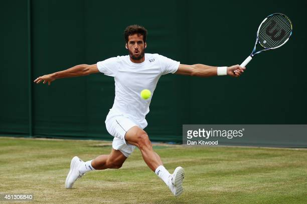 Feliciano Lopez of Spain stretches for return during his Gentlemen's Singles second round match against Ante Pavic of Croatia on day five of the...