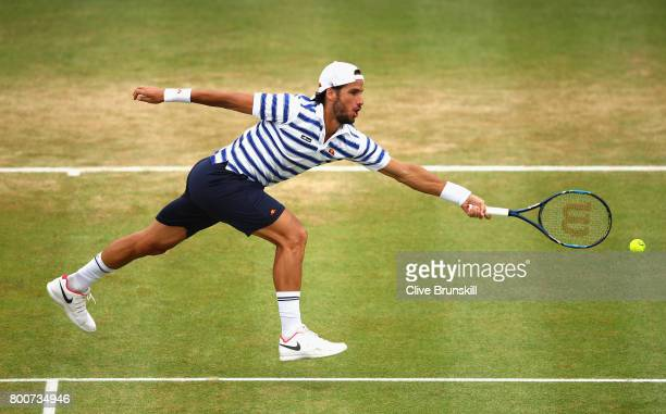 Feliciano Lopez of Spain volleys during the mens singles final against Marin Cilic of Croatia during day seven of the 2017 Aegon Championships at...