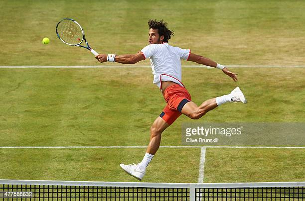 Feliciano Lopez of Spain volleys in his men's singles second round match against John Isner of USA during day four of the Aegon Championships at...