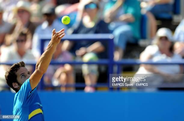 Feliciano Lopez serves against Richard Gasquet in the Men's Singles Final