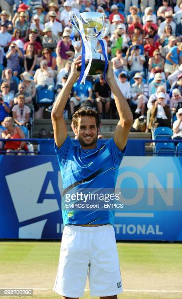 Feliciano Lopez with the Men's Singles trophy after beating Richard Gasquet in the final