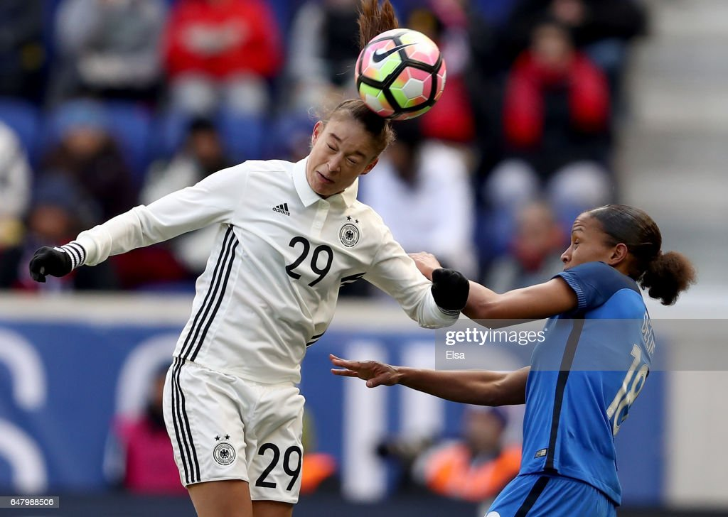 Felicitas Rauch #29 of Germany heads the ball as Marie-Laure Delie #18 of France defends in the first half during the SheBelieves Cup at Red Bull Arena on March 4, 2017 in Harrison, New Jersey.