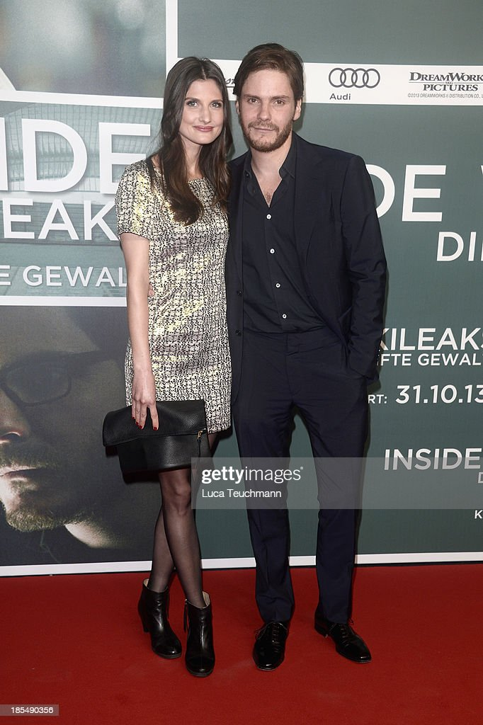 Felicitas Rombold and Daniel Bruehl attend the 'Inside Wikileaks' Germany Premiere at Kulturbrauerei on October 21 2013 in Berlin Germany