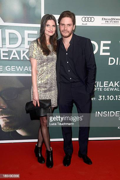 Felicitas Rombold and Daniel Bruehl attend the 'Inside Wikileaks' Germany Premiere at Kulturbrauerei on October 21 2013 in Berlin Germany