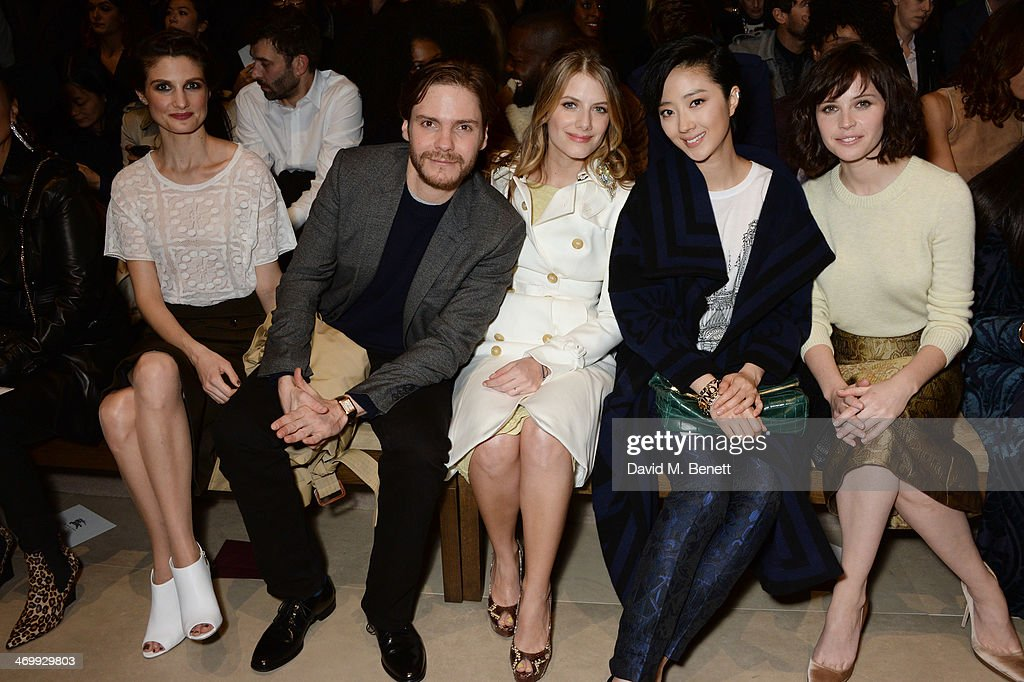 <a gi-track='captionPersonalityLinkClicked' href=/galleries/search?phrase=Felicitas+Rombold&family=editorial&specificpeople=9070735 ng-click='$event.stopPropagation()'>Felicitas Rombold</a>, Daniel Bruhl, <a gi-track='captionPersonalityLinkClicked' href=/galleries/search?phrase=Melanie+Laurent&family=editorial&specificpeople=2721978 ng-click='$event.stopPropagation()'>Melanie Laurent</a>, Guey Lun-Mei and <a gi-track='captionPersonalityLinkClicked' href=/galleries/search?phrase=Felicity+Jones&family=editorial&specificpeople=5128418 ng-click='$event.stopPropagation()'>Felicity Jones</a> attend the front row at Burberry Womenswear Autumn/Winter 2014 at Kensington Gardens on February 17, 2014 in London, England.
