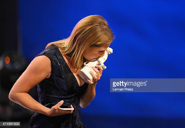 Felicitas Woll awarded as best actress kisses her trophy during the Bayerischer Fernsehpreis 2015 show at Prinzregententheater on May 22 2015 in...